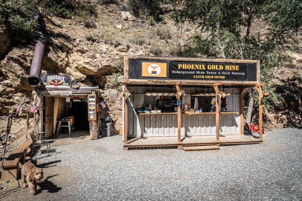 Phoenix Gold Mine in Idaho Springs outside of mine - sign with Phoenix Gold Mine in the side of the mountain