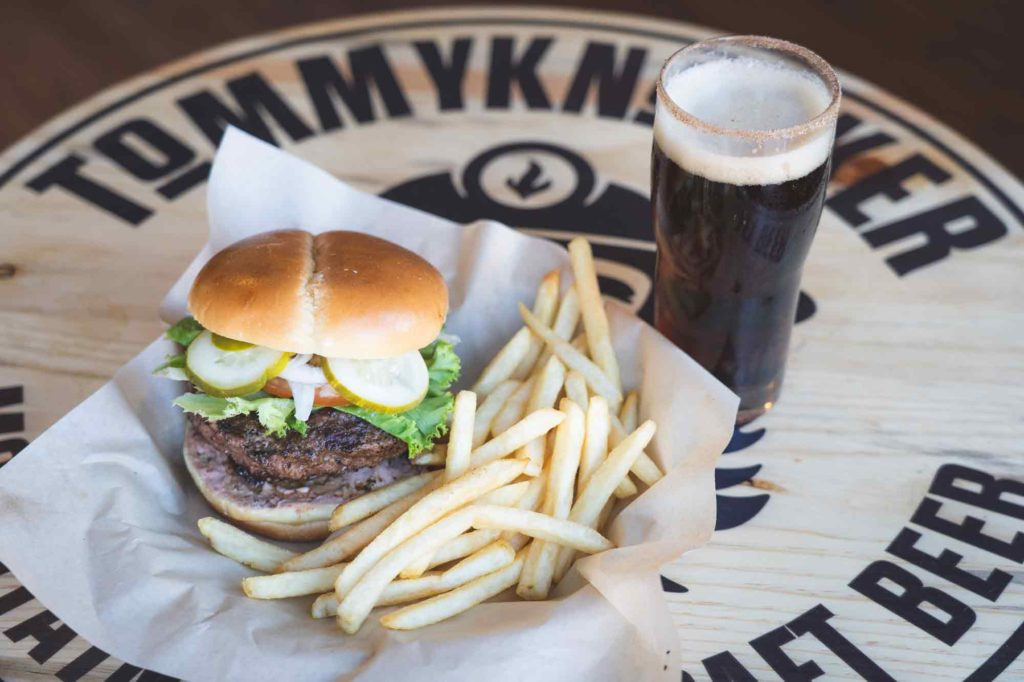 Discover the food in Idaho Springs, CO like this burger, fries, and local beer from Tommyknocker Brewery