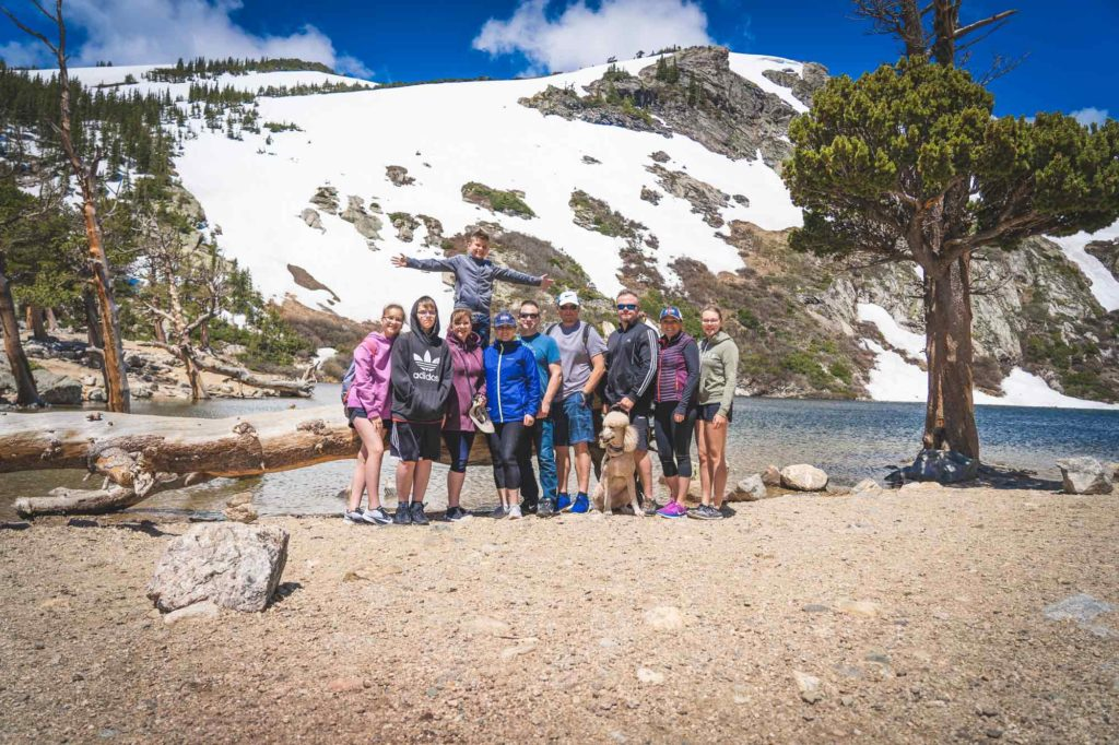 family posing after completing the St. Mary's Glacier Hike