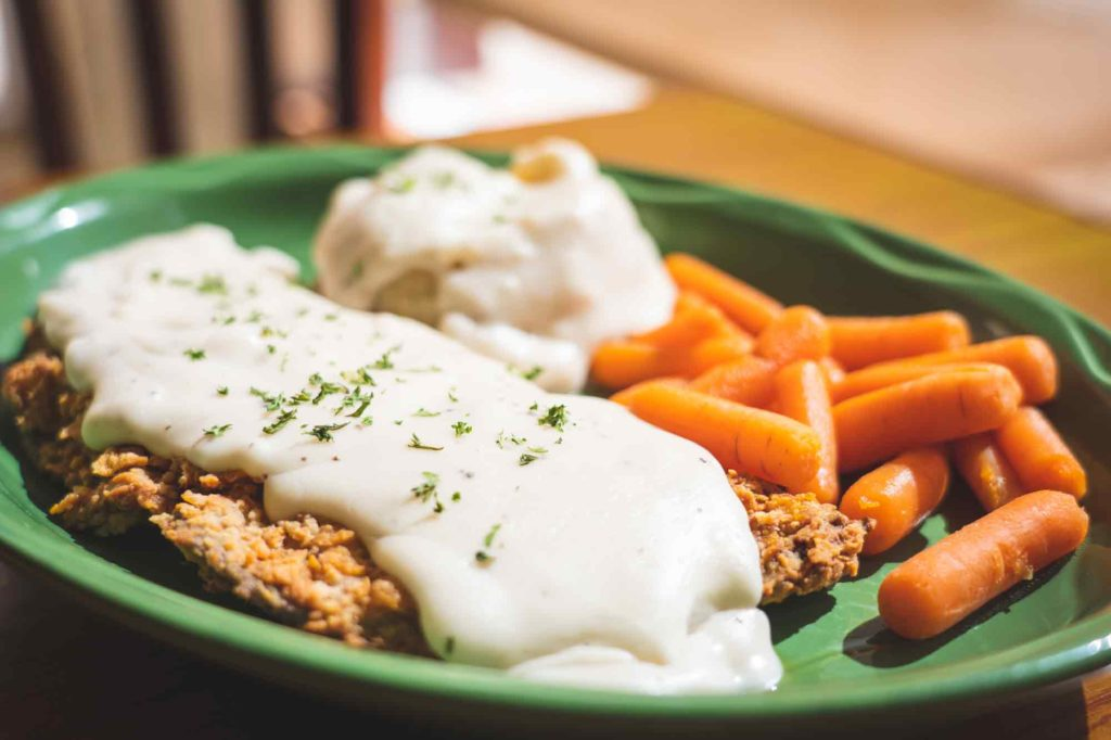 eat some classic grub like Hilldaddy's chicken fried steak smothered in gravy with carrots on the side